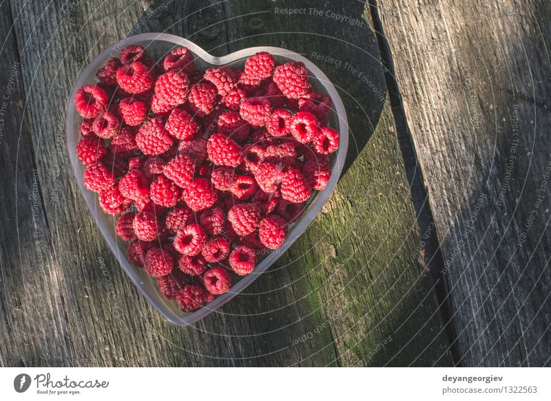 Raspberries in a bowl on wood Nature Green Beautiful Summer White Red Love Natural Feasts & Celebrations Fruit Fresh Heart Paper Romance Symbols and metaphors