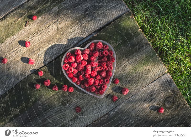 Raspberries in a bowl on wood Nature Green Beautiful Summer White Red Love Natural Fruit Fresh Heart Paper Romance Symbols and metaphors Berries Dessert