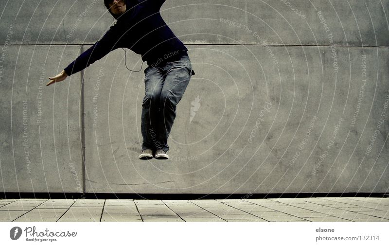 Human being Man Wall (building) Jump Wall (barrier) Lanes & trails Flying Concrete Guy Hop