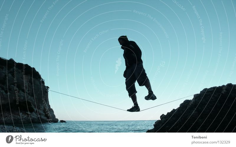 Man Sky Ocean Beach Far-off places Sports Contentment Coast Rope Rock Cool (slang) Island Italy To fall Concentrate