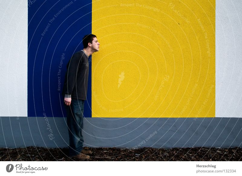 Man Blue Yellow Colour Wall (building) Line Wait Horizon Might Communicate Stand Barrier Left Vertical Right Horizontal