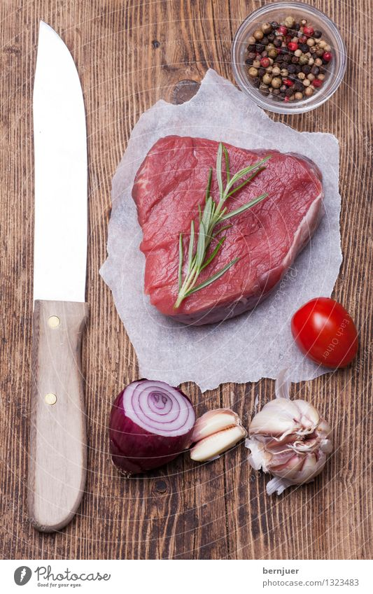 steak Food Meat Vegetable Herbs and spices Eating Organic produce Knives Lie Good Uniqueness Red Authentic beef steak Steak Raw Onion Pepper Tomato Garlic