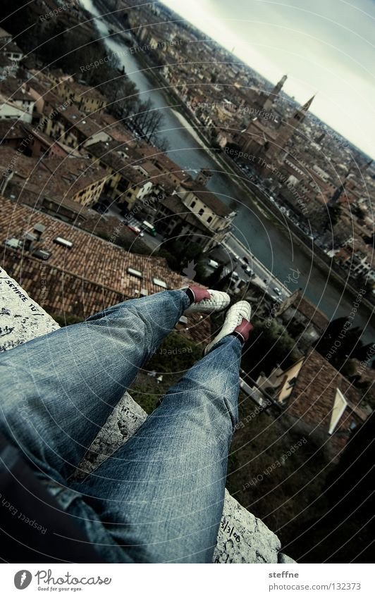 ski flying Footwear Thigh Pants Town Verona Italy Historic Adige Horizon Dangerous Stuntman Edge Cliff Church spire Roof Dramatic Danger of Life Man Lie Legs