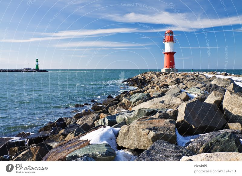 Mole in winter Ocean Winter Nature Landscape Water Clouds Coast Baltic Sea Tower Lighthouse Architecture Landmark Stone Cold Blue Red White Vacation & Travel