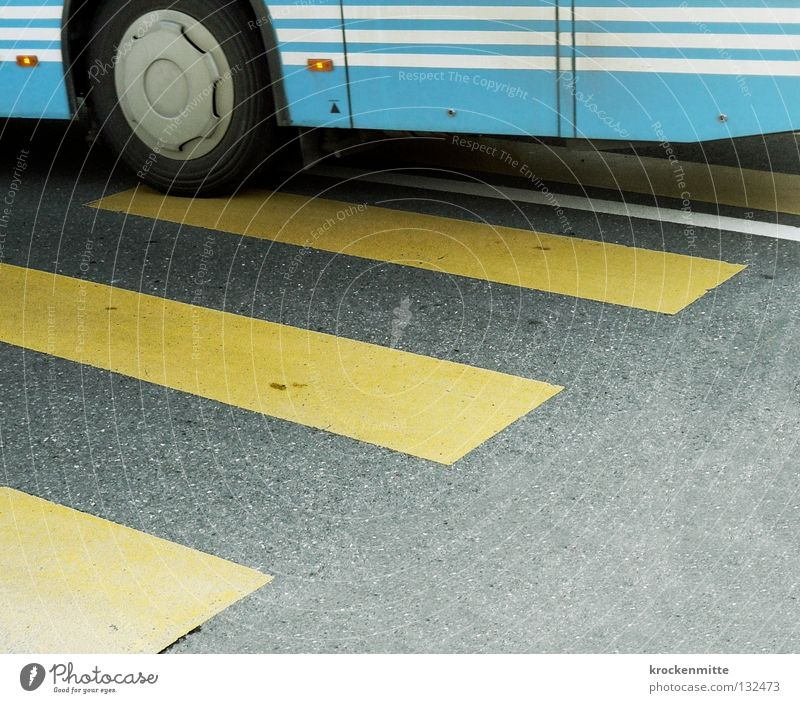 Yellow Street Line Transport Stripe Asphalt Traffic infrastructure Bus Tire Tar Light blue Narrow Zebra crossing Joist Traverse Public transit