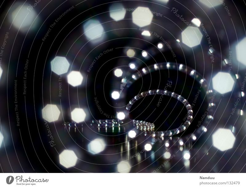 Tunnel to light Light Point of light Spiral Tube light Hose Lamp Decoration Blur Depth of field Dark Infinity Symbols and metaphors Tunnel vision Metamorphosis