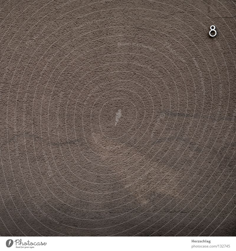 House (Residential Structure) Wall (building) Brown Metal Concrete Circle Digits and numbers Silver 8 Rectangle Minimal Symbols and metaphors Maximum
