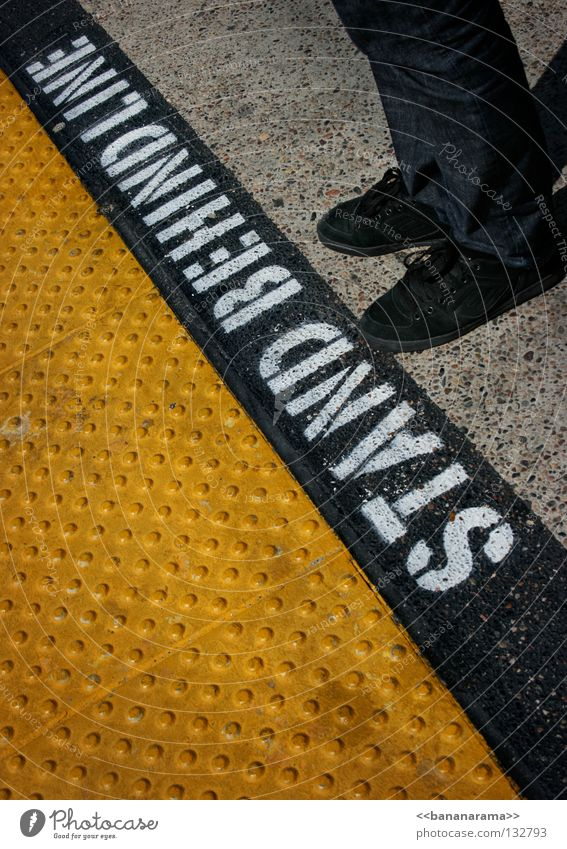 Human being Black Yellow Feet Footwear Line Legs Wait Railroad USA Stand Characters Floor covering Letters (alphabet) Stop Signage