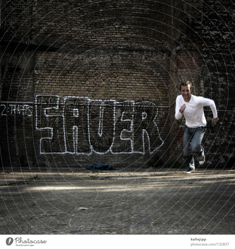 Human being Man Vacation & Travel Graffiti Wall (building) Stone Wall (barrier) Power Fear Walking Action Force Lifestyle Might Brick Running
