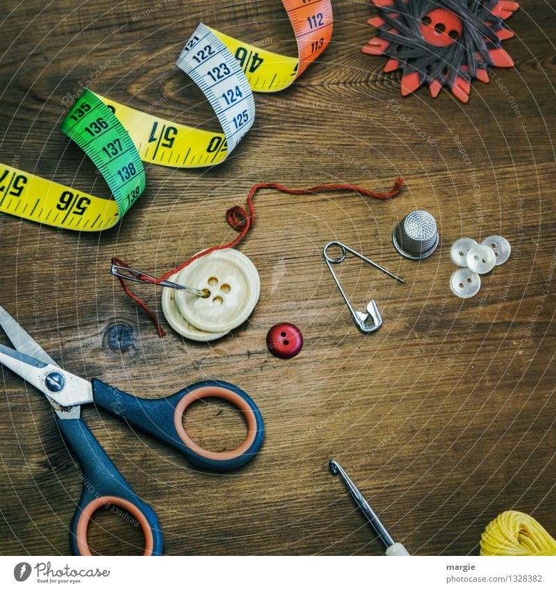 Sewing equipment such as needles, measuring tape, buttons, thread and yarn, thimble scissors, safety needle and a crochet hook Leisure and hobbies Sewing thread