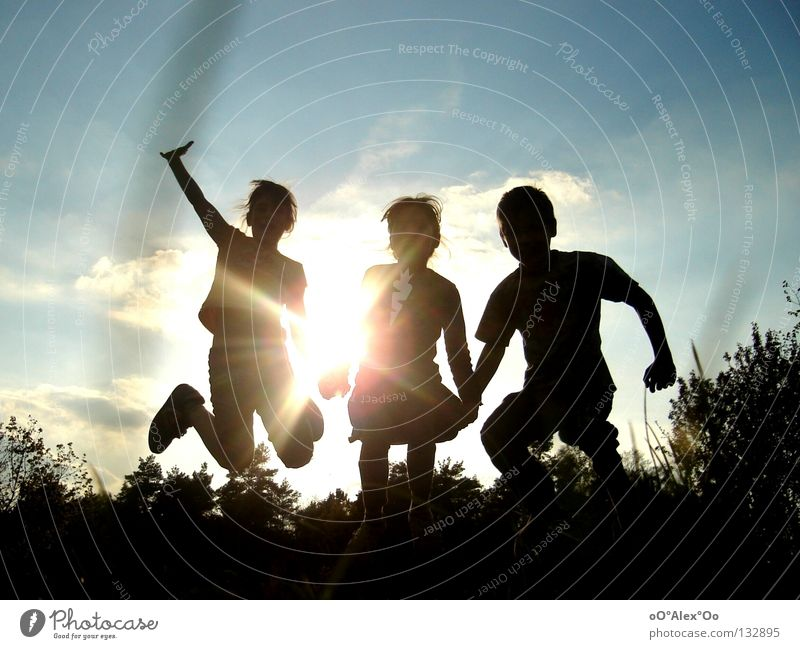 Human being Child Sky Sun Joy Playing Emotions Jump Friendship Facial expression