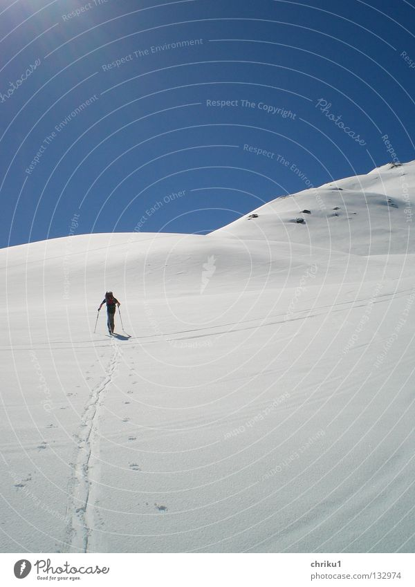 Human being Man Sun Loneliness Calm Snow Sports Playing Mountain Leisure and hobbies Hiking Skiing Alps To enjoy Effort Mountaineering