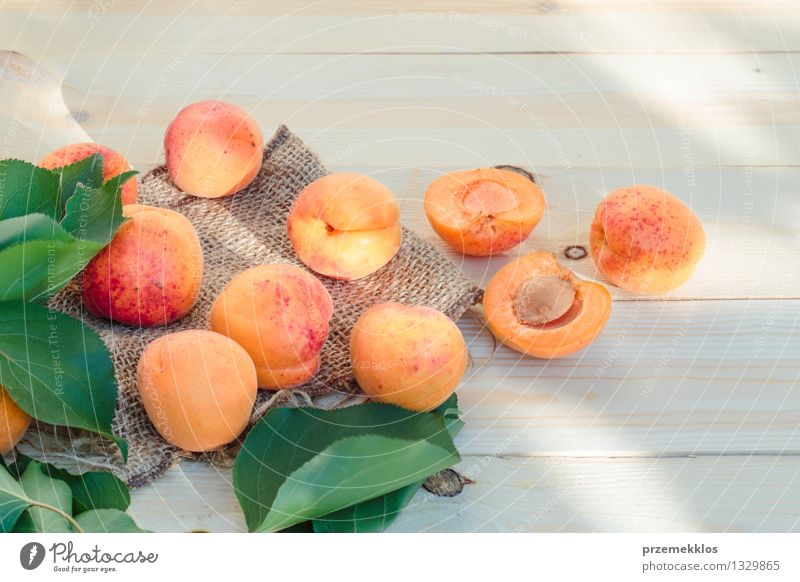 Fresh apricots straight from the garden on wooden table Food Fruit Organic produce Summer Table Nature Leaf Delicious Natural Yellow Green Orange Apricot