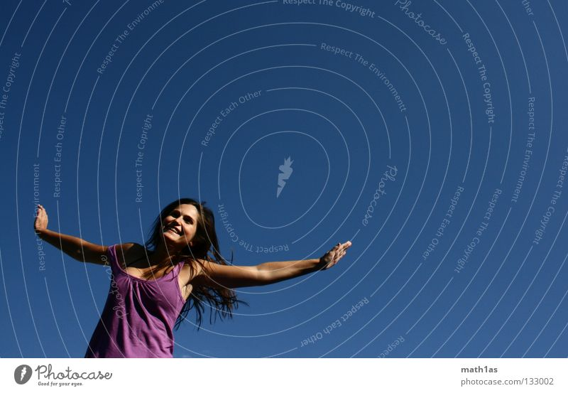 Woman Sky Blue Joy Face Freedom Jump Hair and hairstyles Brown Wind Flying Violet Sports Brunette Trampoline