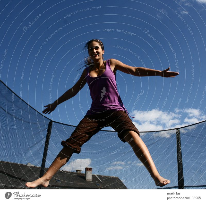 Cramped jumping jack woman Portrait photograph Jump Brown Woman Brunette Violet Trampoline Joy Hair and hairstyles Wind Sky Blue Flying hitchhike little bird