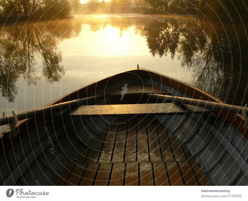 early-morning exercise Rowboat Watercraft Lake Pond Gravel pit Contentment Mirror image Morning Sunrise Romance Navigation Playing Motor barge wooden boat