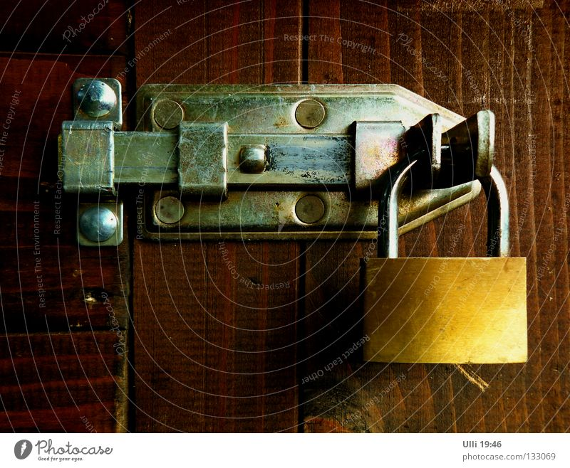 No getting through! Calm Door Wood Rust Lock Safety Protection Closed Locking bar Padlock Barrier Rivet Colour photo Subdued colour Exterior shot Close-up