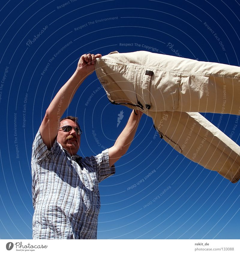 Man Ocean Joy Beach Sand Air Waves Arm Wind Wet Tall Clothing Island Pants Fat Blow