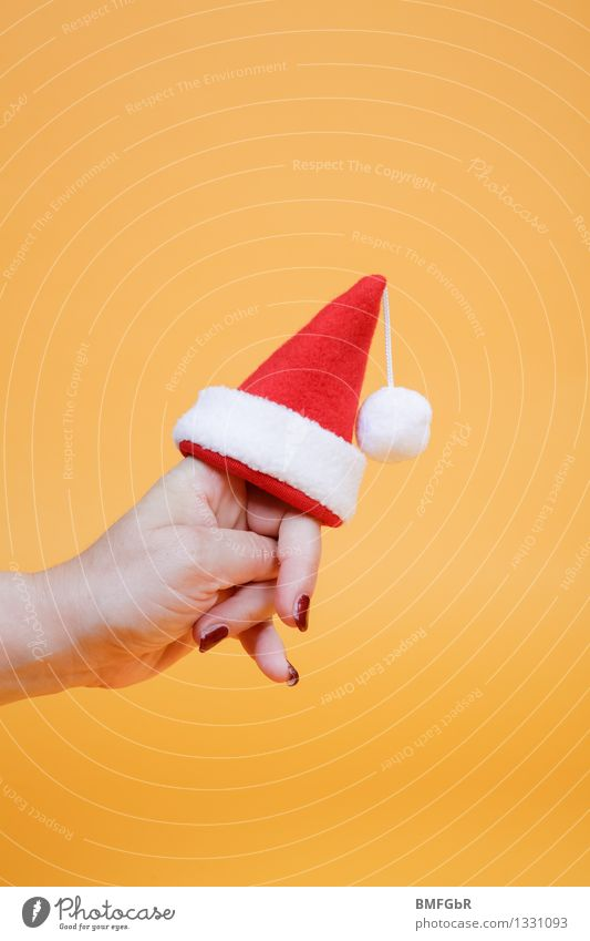 Christmas is coming... Joy Feasts & Celebrations Christmas & Advent Hand Fingers 1 Human being Santa Claus Santa Claus hat Tuft Sign To hold on Carrying