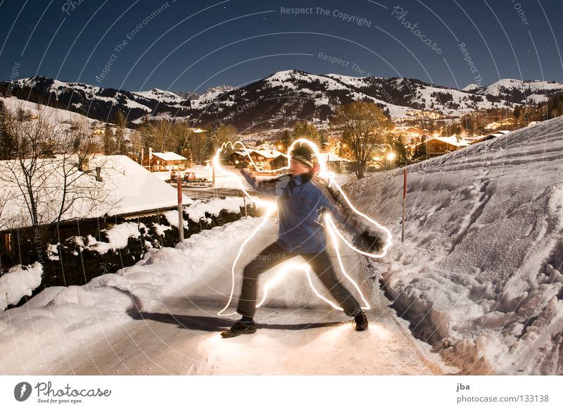 yet again... Long exposure Light Lamp Man Virgin snow Stand Gstaad Mountain Snow Street Joy Shadow Draw Painting (action, work) Blue