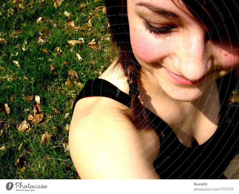 summery smile Colour photo Downward Joy Summer Feminine Young woman Youth (Young adults) Head 1 Human being Meadow Brunette Braids Laughter Happiness Warmth