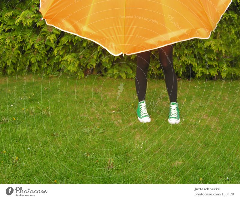 The woman without upper body Sunshade Umbrella Green Meadow Grass Agent Summer Garden Park Legs Pantyhose Pantyhose Sneakers Orange Lawn Protection Hide