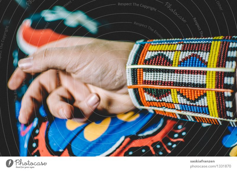 African beads. Lifestyle Exotic Manicure Hand Fingers Fashion Clothing Jewellery Hip & trendy Kitsch Bracelet Massai Pattern Pearl Afro Colour photo