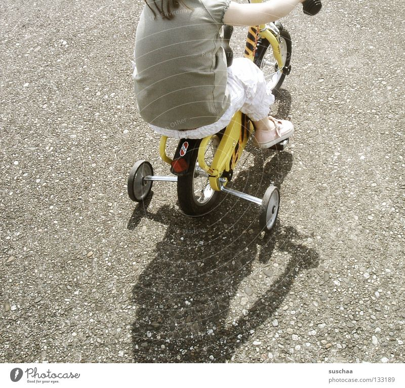 Child Girl Joy Street Small Sit Driving Leisure and hobbies Asphalt Brave Toddler Cycling Brash Freestyle Stunt