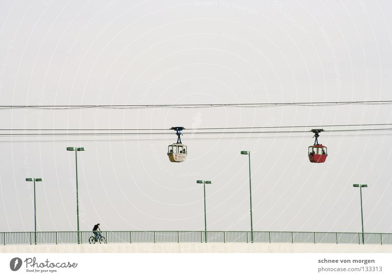 Look into the country Driving Cable car Bicycle Lantern Gray Direction Transport Cologne Zoo bridge Bridge Rope Gondola Horizon Bright background Isolated Image