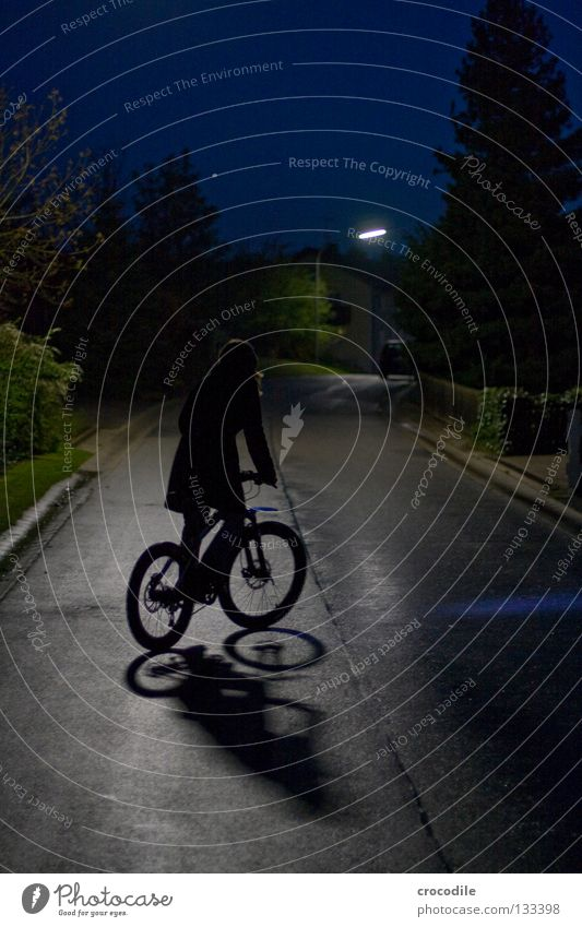 lonely biker II Night Motorcyclist Driving Balance Bicycle Mountain bike Tar Tree Fir tree Light Lantern House (Residential Structure) Concentrate Joy Power