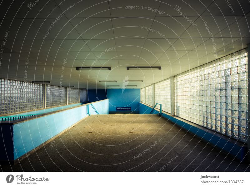 apparently entrance of the S-Bahn GDR Marzahn Entrance Window Traffic infrastructure Commuter trains Train station Authentic Sharp-edged Retro Gloomy Blue