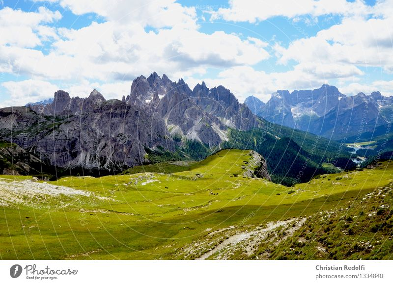 mountains Mountain Peak Snowcapped peak Clouds Above the clouds Meadow Alpine pasture Hiking Mountaineering Freedom Dolomites Sky Light Shadow Mountain meadow