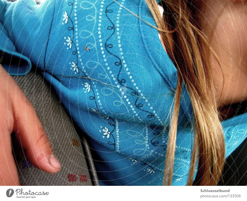 Boredom in the car Hair and hairstyles Skin Sweater Cloth Blonde Dark Bright Blue Red Thumb Fingernail Car seat Neck Point Flowery pattern Detail Pattern