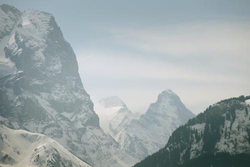 Steep mountains Switzerland Panorama (View) Might Wall (building) Playing Mountain Alps Landscape Tall Snow Rock mountain face Large