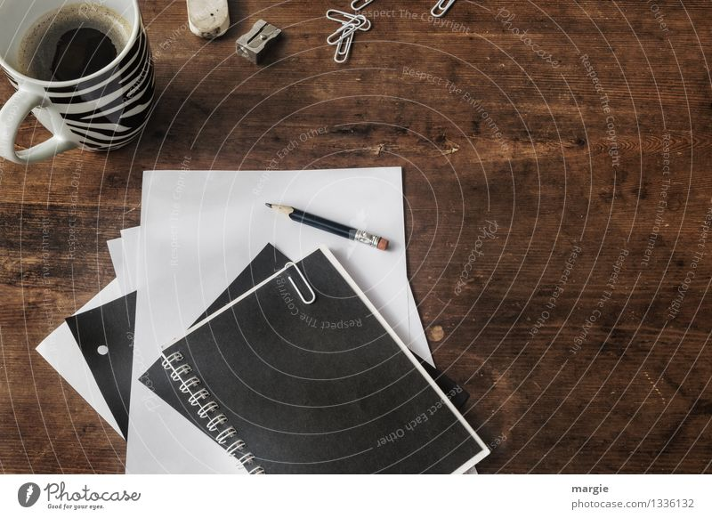 Desk with coffee cup, staples, pencil, paper clips, eraser and sharpener all in black and white Beverage Hot drink Coffee Cup Professional training