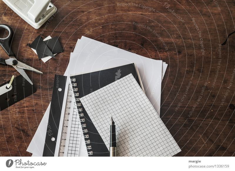 Desk with staplers, paper, pen, scissors, stapler, punch all in black or white Leisure and hobbies Education Science & Research Adult Education School Study