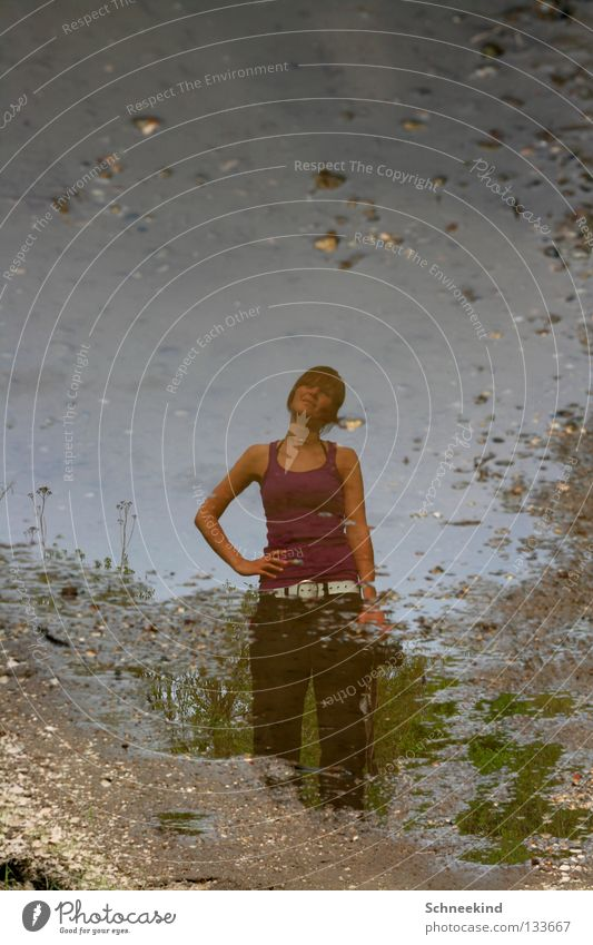 Puddle-Schatzi Wet Woman Mirror Mirror image Pebble Gravel path Joy Rain To go for a walk Water Trip