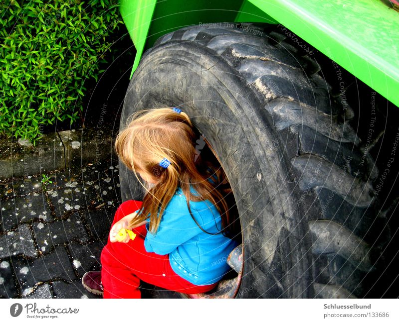 Child Green Blue Girl Red Black Gray Hair and hairstyles Footwear Blonde Sit Bushes Cloth Wheel Boredom Tire