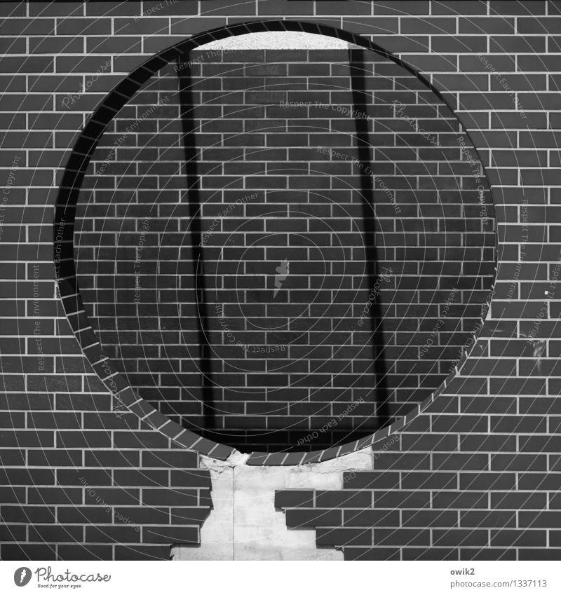 peephole Wall (barrier) Wall (building) Facade Sharp-edged Simple Round Brick Decoration Hollow Large Shopping arcade Pedestrian precinct Black & white photo