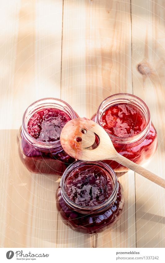 Homemade jam on wooden table Fruit Jam Nutrition Breakfast Organic produce Spoon Summer Table Nature Fresh Delicious Natural Red Tradition food glass healthy