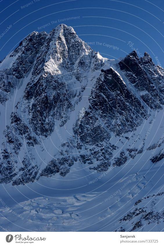 Beautiful Winter Snow Mountain Rock Peak Austria Blue sky Steep Grossglockner High mountain region Steep face Snowcapped peak