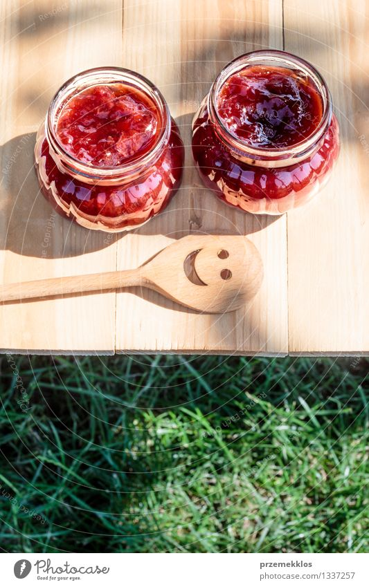 Homemade jam on wooden table Fruit Jam Breakfast Spoon Summer Table Nature Grass Fresh Delicious Natural Red Tradition food glass healthy Home-made Ingredients