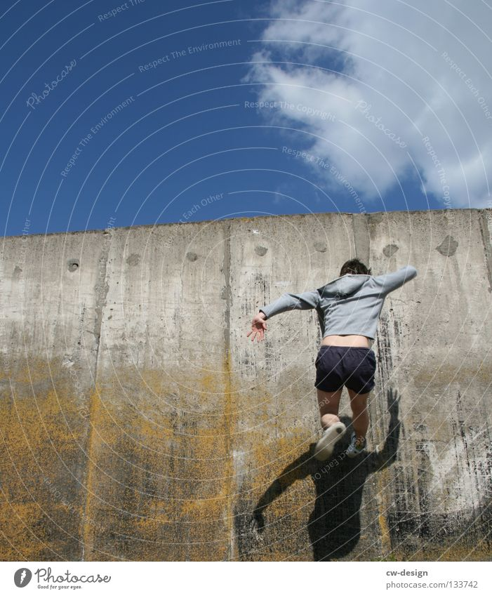 Human being Man Youth (Young adults) Joy Wall (building) Freedom Jump Glass Flying Walking Masculine Concrete To fall Running Athletic