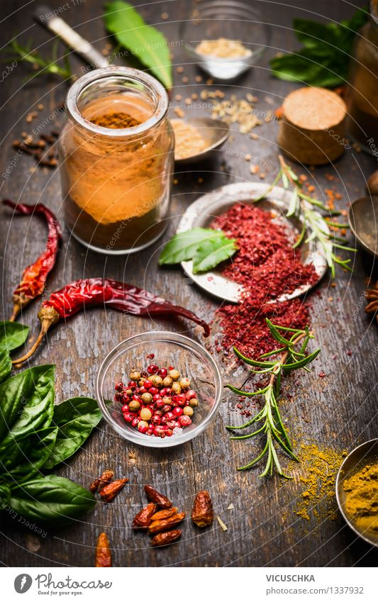 Colourful spices on the kitchen table Food Herbs and spices Nutrition Organic produce Vegetarian diet Diet Slow food Plate Bowl Glass Style Design