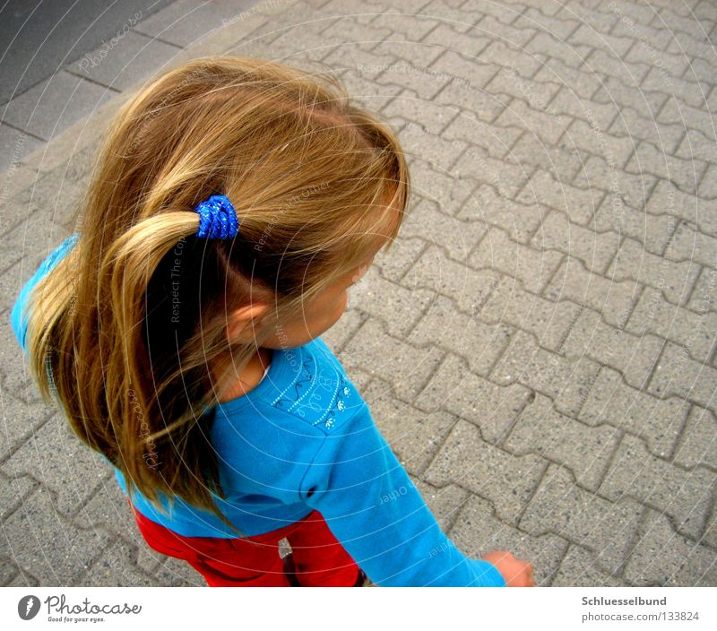 Child Blue Girl Red Street Dark Hair and hairstyles Stone Bright Brown Blonde Stand Pants Footpath Sweater Long-haired
