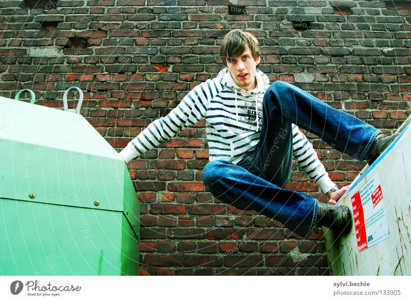 let´s go another way Beautiful Man Adults Wall (barrier) Wall (building) Jeans To hold on Jump Athletic Tall Above Green Power Striped Trash container Go up