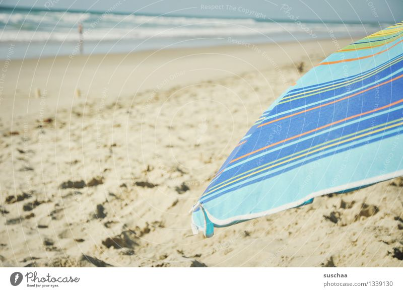 sun + umbrella = parasol Sunshade Sand Beach Ocean Water Waves Cloth Striped vacation holidays Summer Relaxation
