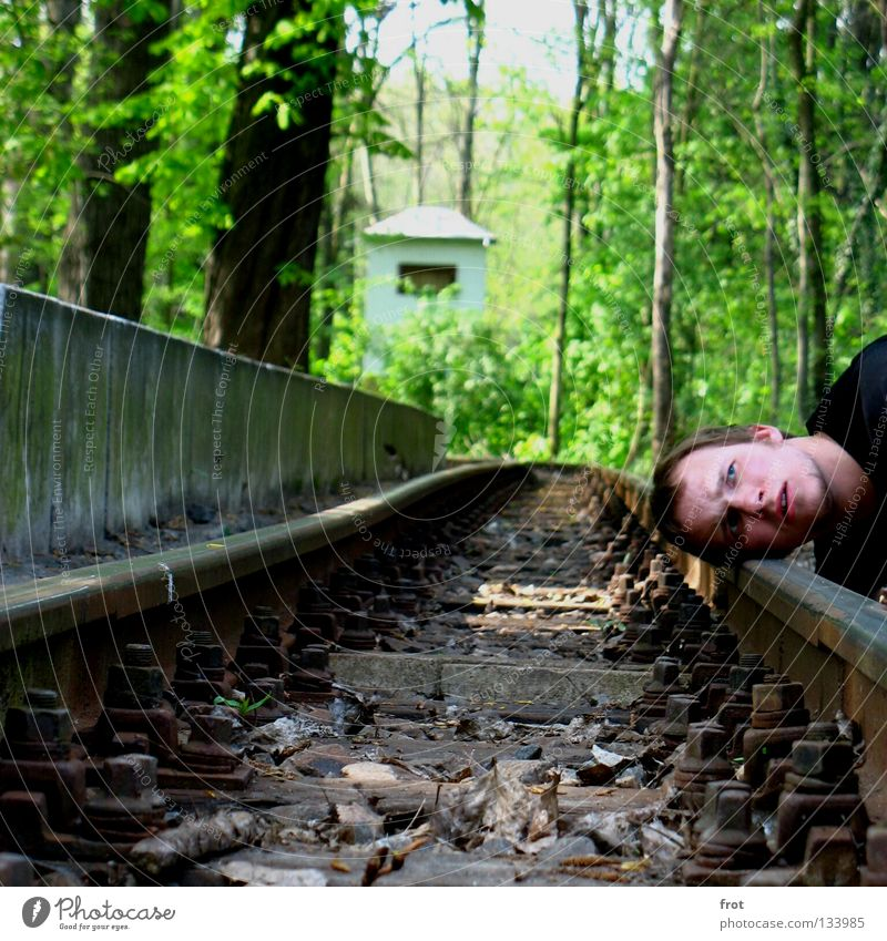 and does he come? Railroad tracks Listening Green Platform Train station Head Wait Ear Human being