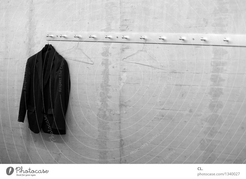 The last one turns off the light Wall (barrier) Wall (building) Fashion Clothing Jacket Clothes peg Hanger Services Black & white photo Interior shot Deserted
