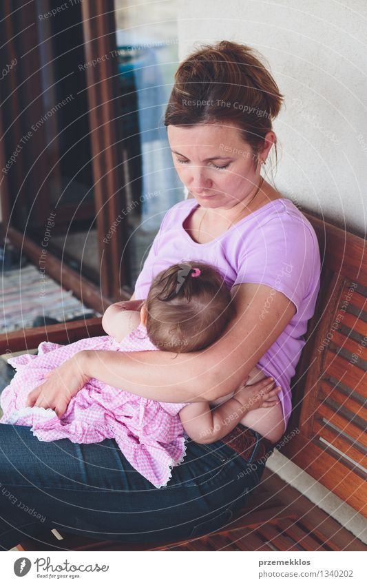 Mother breastfeeding her little baby on the patio Human being Woman Child Beautiful Girl Adults Life Love Family & Relations Small Lifestyle Together Infancy